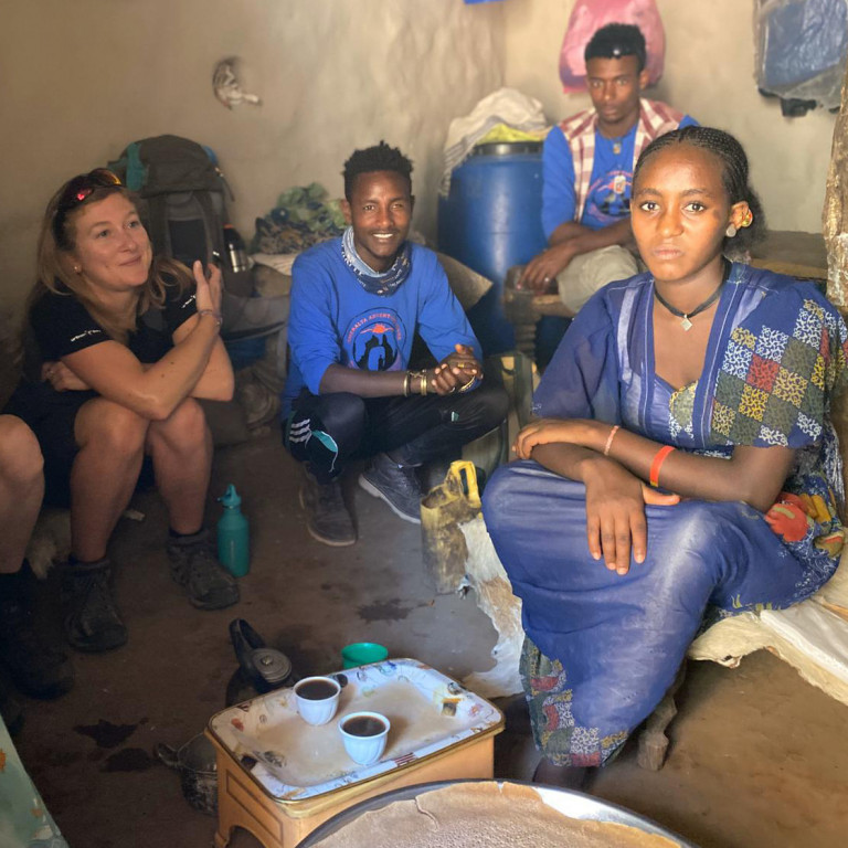 Sharing coffee with locals inside Ethiopian Hut, Gheralta, Ethiopia