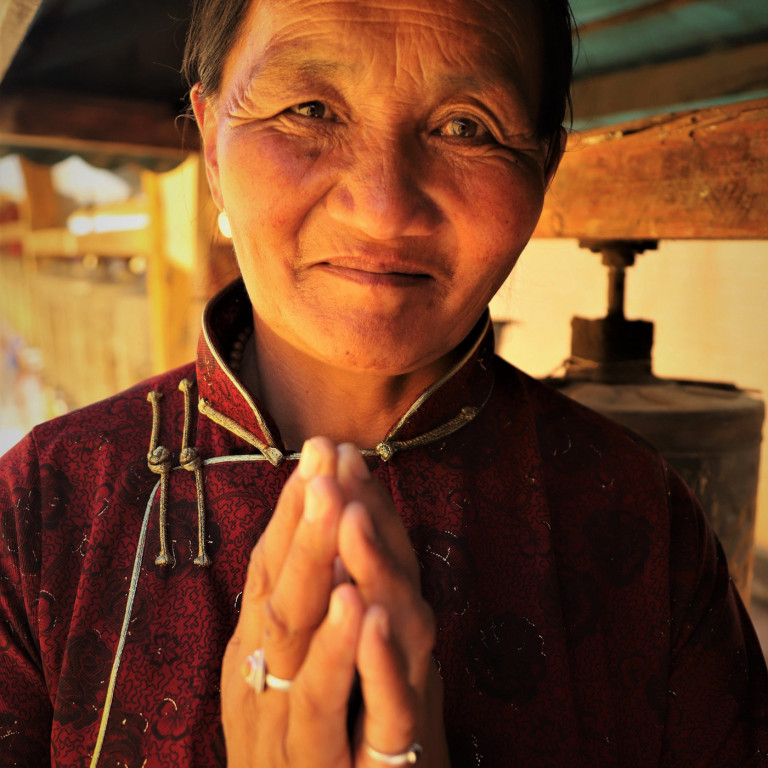 Mongolian Woman with Prayer Wheel