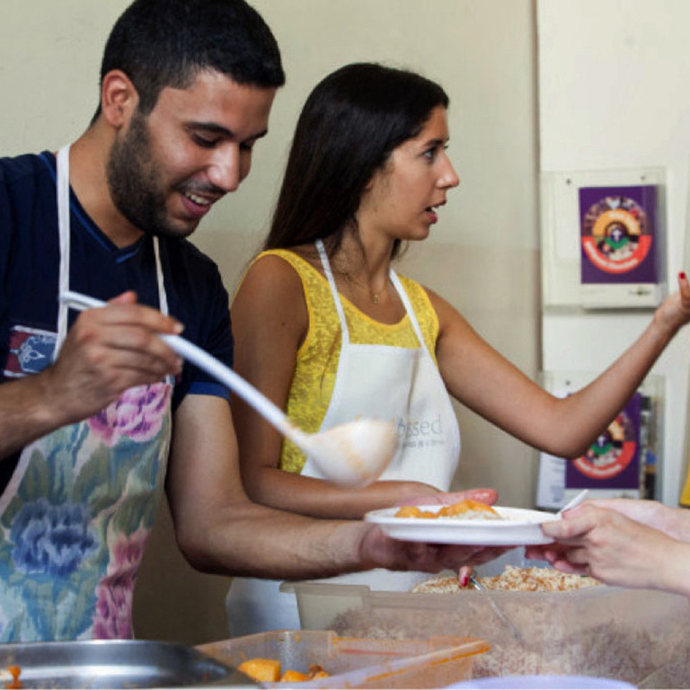 Serving meals at centre for refugees, Food Blessed, Lebanon