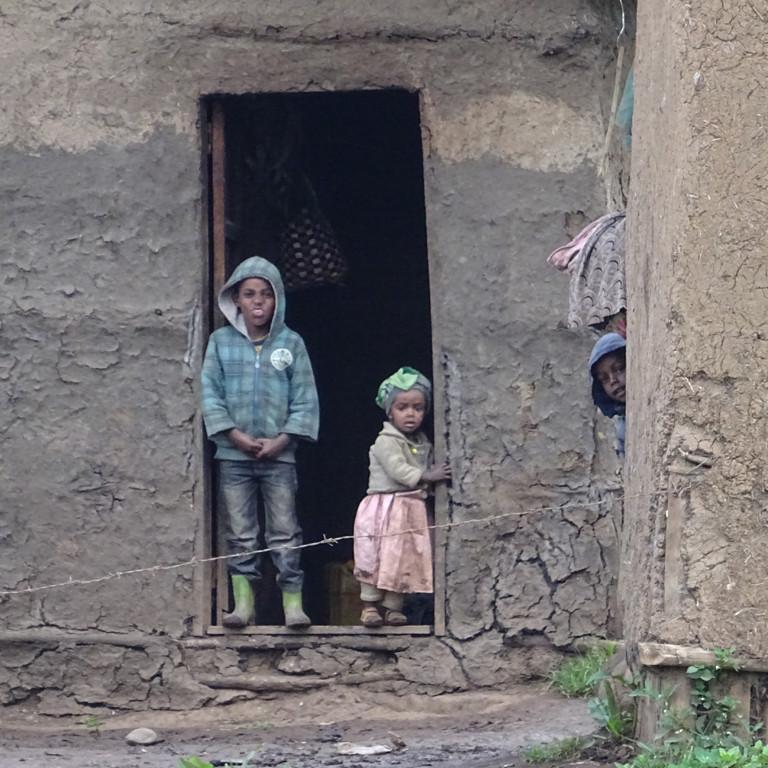 Children outside their home, Bale Mountains, Ethiopia