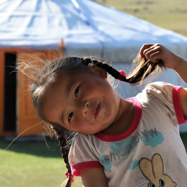 Young girl with pigtails, Host Family, Mongolia