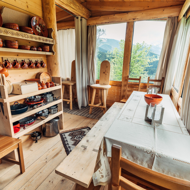 Dining area with a view-Wilderness Cabin Experience-Romania