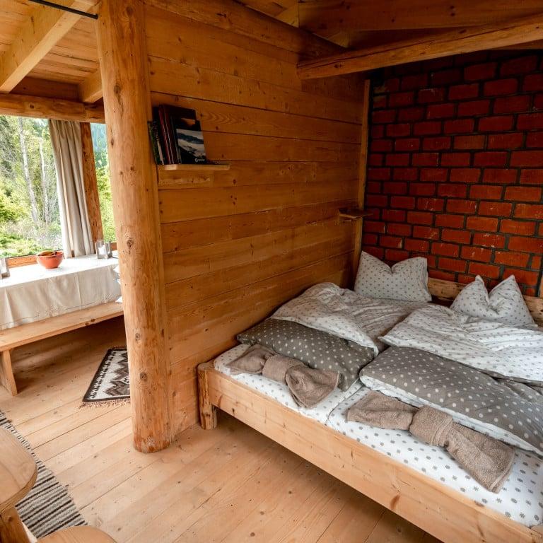 Double bed in Bunea Wilderness Cabin Experience-Romania